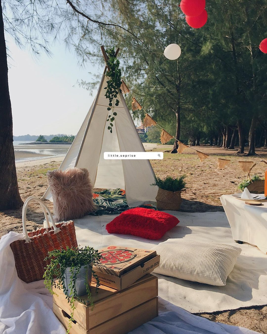 A cute picnic rental service with a tepee on the beach