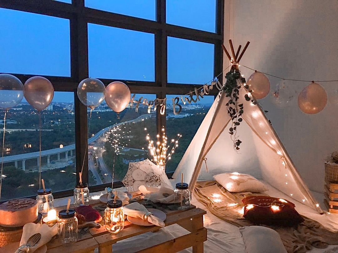 An indoor party with a tepee