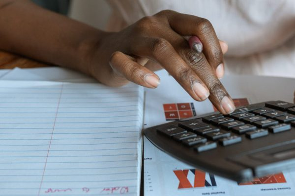 Woman budgeting and calculating her expenses